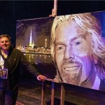 Peter Engels poses with his latest, a portrait of billionaire businessman Richard Branson.  Photo credit: Tom Berzels © laloza.be