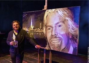 Peter Engels poses with his latest, a portrait of billionaire businessman Richard Branson.  Photo credit: Tom Berzels © laloza.be