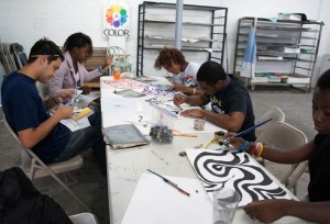 Teaching Artist Carlos Noguera (far left) begins a design project with the Artworks interns at the Bakehouse Art Complex in Wynwood